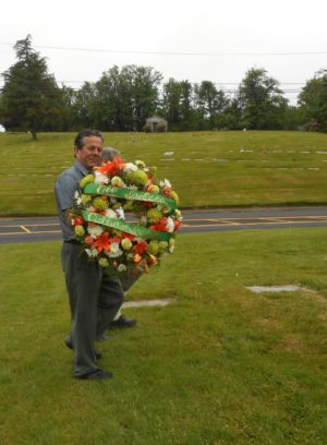JJ Holding The Wreath